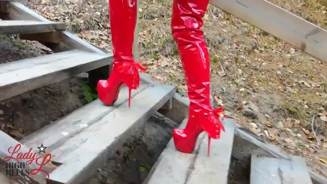 Lady lee walking in forest with hawt xtreme twenty cm high red boots.