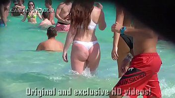 Have to watch legal age teenager pawg in a strap bikini on the beach in public