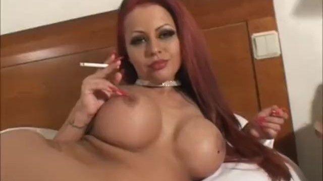 Hawt large tit smokin redhead masturbating