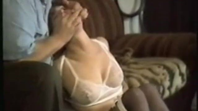 Dude binds gagged woman in white lingerie, then ties her to chair