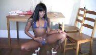 Hawt dark brown legal age teenager and light blue micro bikini undress tease on web camera